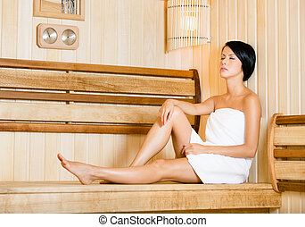Half-naked girl relaxing in sauna Concept of self-care,...