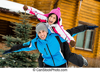 Cute couple having fun during winter holidays - Half-length...