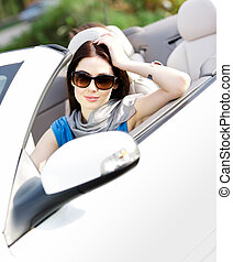 Portrait of dreamy woman in the cabriolet