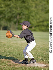 Little Boy Playing First Base - Little Boy Playing Baseball...