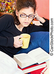 woman reading book at home