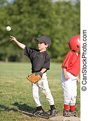 Little Boy Throwing Baseball - A Little Boy Throwing...
