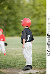Little Base Runner on First Base in a Baseball Game