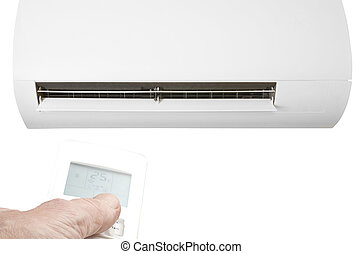 Hand with remote control directed on the air conditioning