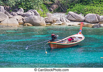 Longtail boat on beach of koh tao in the gulf of thailand