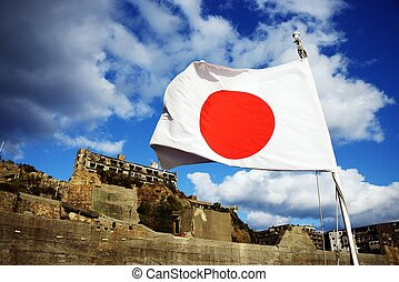 Gunkanjima - Japanese flag flutters over the bandoned island...
