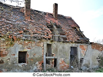 an old abandoned farmhouse in the countryside