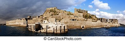 Gunkanjima - Abandoned island of Gunkanjima in off the coast...