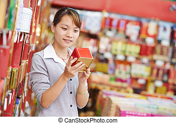 chinese woman shopping food - chinese young woman choosing...