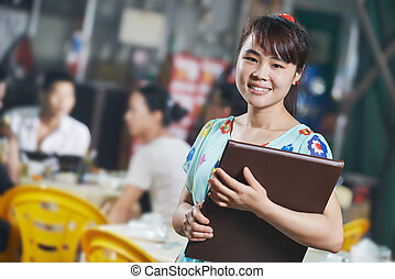 Waitress chinese girl of restaurant with menu - Chinese...