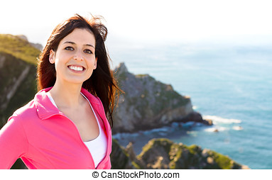 Happy woman on summer coast landscape travel - Woman smiling...