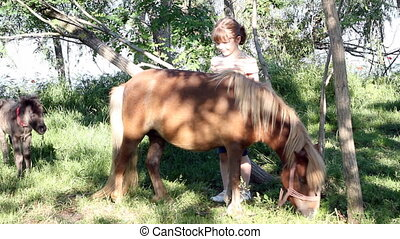 little girl with pony horse and foal