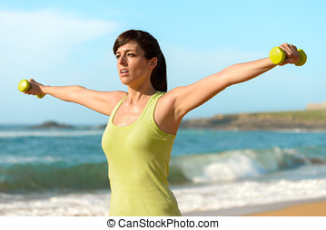 Fitness woman working out on beach