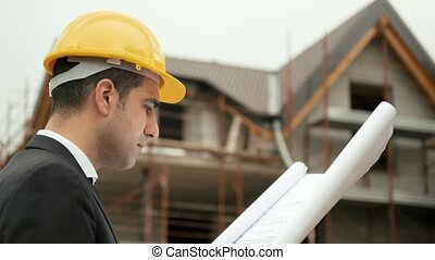 Man working, architect on site - Young man working as...