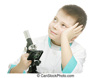 Dreaming researcher - Schoolboy in lab smock dreaming photo...