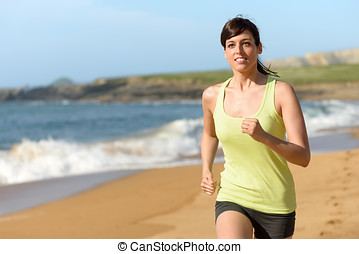 Female athlete running on beach