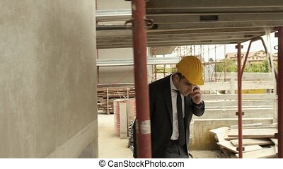 Engineer talking on mobile phone