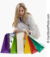 Happy shopper - Attractive blond woman wearing grey business...