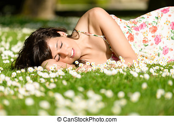 Woman resting and relaxing on nature