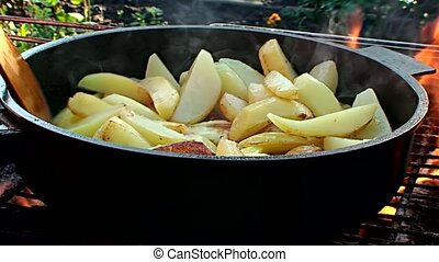 fried potatoes - potatoes fried on fire
