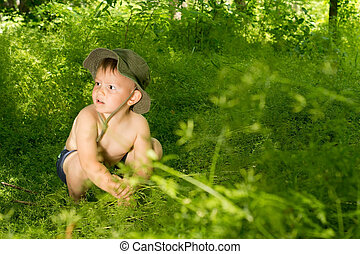 Surprised young small boy discovering nature, while...