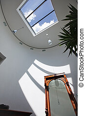 Sunroof With Shadow On Wall - Low angle view of sunroof with...