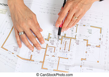 architect working on ground plan - woman´s hands with pencil...