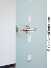 metallic door´s handle - modern glass door and metallic...