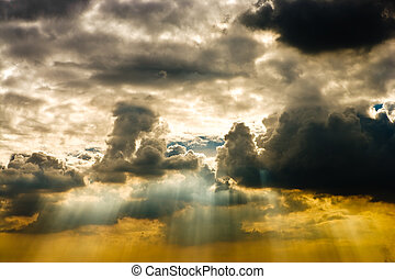 Cloudscape with sun ray shining through.