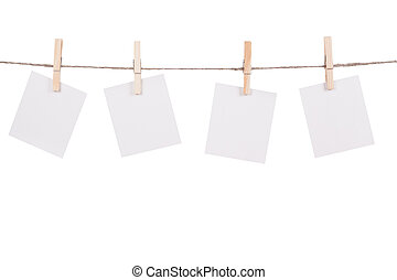Blank instant photo hanging on the clothesline Isolated on...