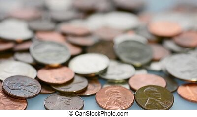 Many different coins on a table - Random change layed on a...