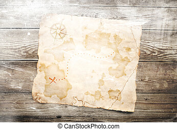 old treasure map on wooden background - old treasure map on...