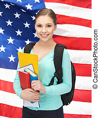 student with books and schoolbag - smiling student with...