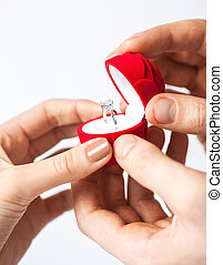 couple with wedding ring and gift box - couple hands with...