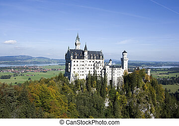 Neuschwanstein castle in autumn, Bavaria, Germany -...