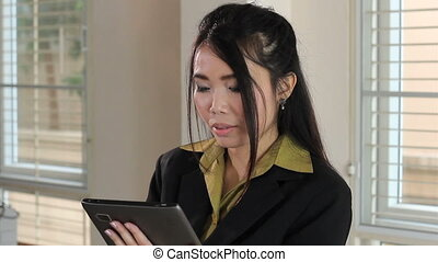 Serious Asian Office Worker - An attractive female Asian...