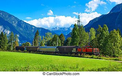 Alps landscape - Alps mountains landscape with train.