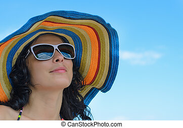 Stunning woman in a colourful straw sun hat - Stunning...