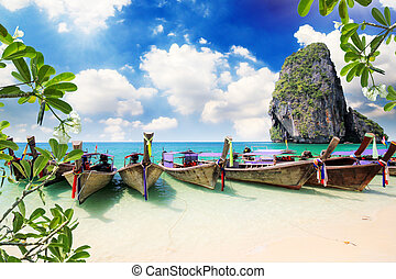 Railay beach in Krabi Thailand - Long tail boat on tropical...