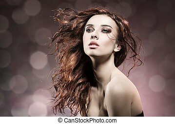 fashion girl with flying hair on flare background - fashion...
