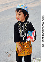 Young boy holding flag