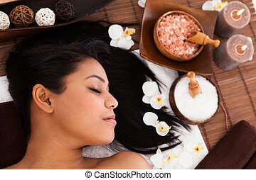 Young Woman Relaxing In A Spa - Young Woman With Her Eyes...