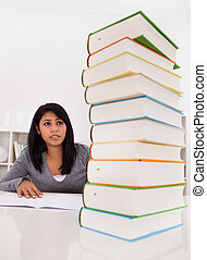 Shocked Woman Looking At Stack Of Books Indoor