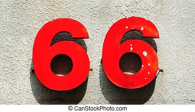 metal number 66 - red metal number 66 hanging on the...