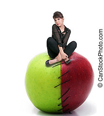 Woman on a Stitched Apple - Beautiful woman sitting on a red...