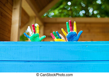 Children showing colorful painted hands - Children showing...