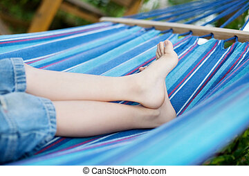 children feet in the hammock - close-up of little child...