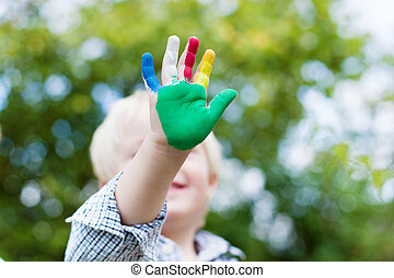 colorful little hand - Young Caucasian child showing his...