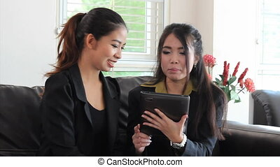 Asian Office Workers Using Tablet