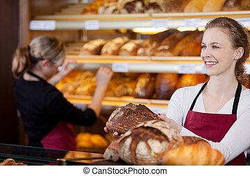 vendedora, panadería, frente, Estantes